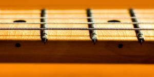 why do guitar necks warp