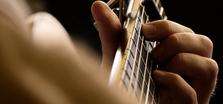 does guitar build muscle