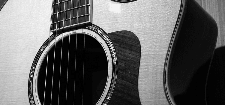 why does my acoustic guitar sound dull
