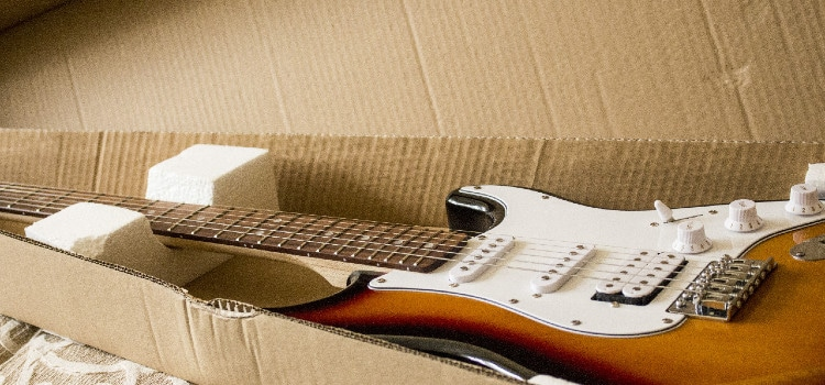 cheapest way to ship a guitar