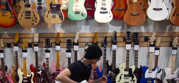 laminate vs solid wood guitar