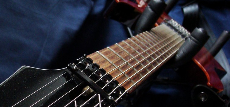 is a 7 string guitar hard to play